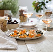 Salmon canapés on a table laid for a party