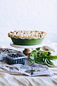 A blueberry pie on a platter