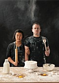 A messy couple baking a cake