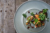 Wild mushroom salad with winter vegetables, goat's cheese, pecan nuts and bacon vinaigrette