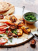 Barbecued tandoori fish skewers with tomatoes