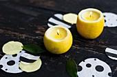 Selbstgemachte Zitronen-Kerzenhalter und Konfetti als Tischdeko