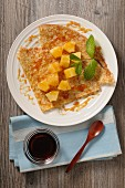 Crêpes with pineapple and caramel sauce