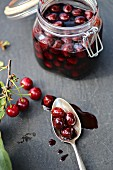 Preserved sour cherries on a slate surface