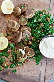 Lamb meatballs with a parsley and tomato salad, a yoghurt dip and lemons