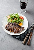Beef steak with rocket salad