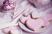 Pastel coloured heart-shaped biscuits on a plate