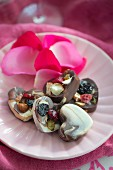 Heart-shaped chocolates with dried fruit and nuts