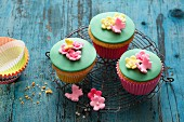 Flower Power muffins with colourful fondant decorations