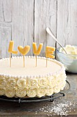A marzipan buttercream cake decorated with the word 'Love'