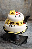 A strawberry and buttercream 'crime scene' cake decorated with fondant icing