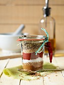 A spice mixture for a BBQ marinade in a glass as a gift