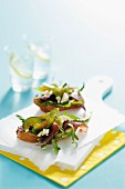 Bruschetta topped with biltong, candid figs and blue cheese