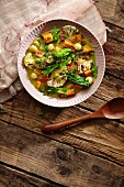 Sweet potato curry with rapini, cauliflower and macadamia nuts