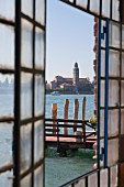 A view through the window of the glass blowing factory towards Cannaregio on the island of Murano near Venice, Italy