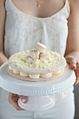 A macaroon cake with white chocolate mousse