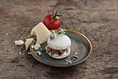A macaroon with a savoury Parmesan and Parma ham filling