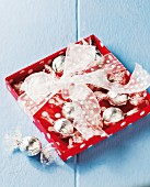 Chocolate pralines in silver foil as a gift