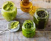 Three jars of homemade green pesto