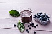 A blueberry and spinach smoothie with coconut water