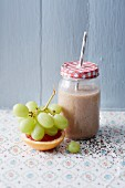A banana and chia smoothie with grapes and grapefruit