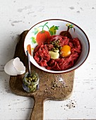 Beef tartare with an egg yolk and capers