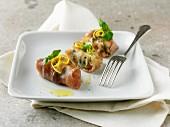 Parma ham rolls with lemon zest