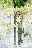A draining spoon and elderflowers