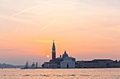 The sun coming up over the Chiesa di San Giorgio Maggiore, Venice, Italy