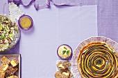 Fruit and nut quinoa salad, Spiral vegetable tart, Dukkah polenta with chermoula