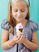 Girl holding ice-cream cone cupcakes