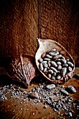 Cocoa pods and cocoa beans on a wooden surface