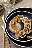 Chicken roulade filled with mushrooms served with chestnut purée and fried diced celeriac