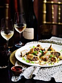Aromatic lamb spring rolls with labne and taosted grains