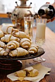 Rugelach or Rogaliki (Russian jam pastries) with champagne