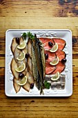 Cold fish platter with herring, salmon, whitefish and olives (Russia)