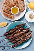 Pork souvlaki kebabs served with tzatziki and bread