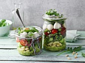 A layered green asparagus and pasta salad in jars