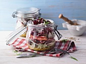 A layered fennel salad with salami in a jar