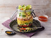 Layered curry rice salad with chicken in a jar