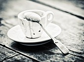 An empty espresso cup with a spoon (black-and-white shot)