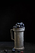 Blueberries in a rustic ceramic cup