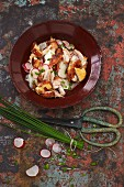 Roast chicken salad with radishes, croutons and chive vinaigrette