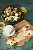 Roasted cauliflower salad with beluga lentils and spicy yoghurt
