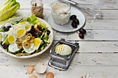 Mediterranean egg salad with olives and courgette strips