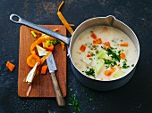 Roasted semolina soup with carrots and peas
