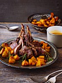 Lamb chops in orange sauce with baked potatoes