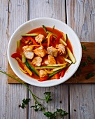 Tomato and fish goulash with peppers, cucumber and courgette