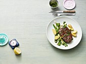 Beef steak with potatoes, spring onions and wild garlic oil (Paleo diet)