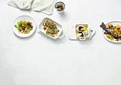 Vier Fischgerichte aus dem Ofen mit Würzghee (Paleo-Diät)